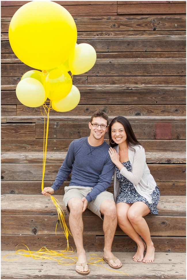 bunch of yellow balloons engagement photo prop