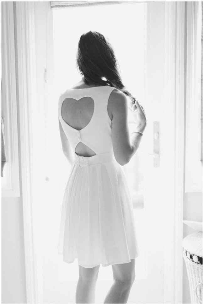 white getting ready dress with heart shaped back photo